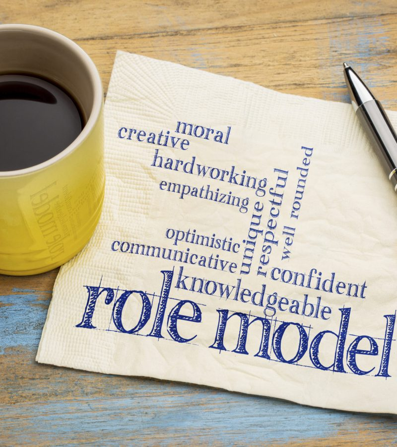 role model qualities word cloud -handwriting on a napkin with a cup of coffee
